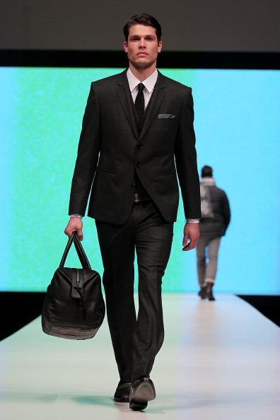 Показ чоловічої колекції від Hugo Boss у Сінгапурі на Чоловічому тижні моди .Фото: Chris McGrath / Getty Images