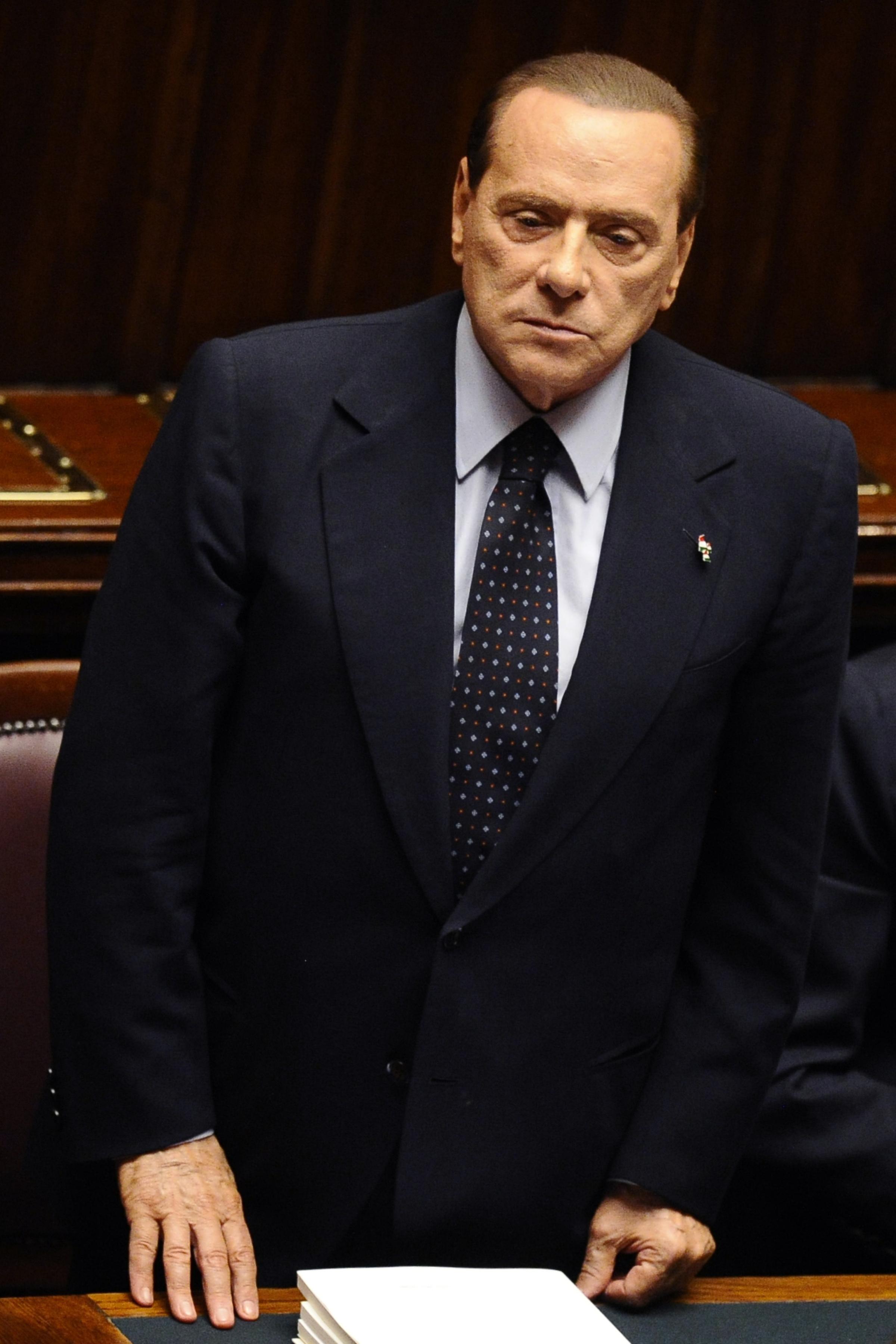 Премьер-министр Италии Сильвио Берлускони реагирует на заседании в парламенте по принятию пакета ключевых экономических реформ. 12 ноября 2011 года, Рим. В тот же день он ушел в отставку. Фото: Filippo Monteforte/Getty Images