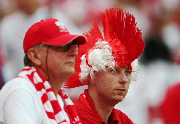 Польские болельщики на матче между Польшей и Грецией 8 июня 2012 года в Варшаве, Польша. Фото: Michael Steele / Getty Images
