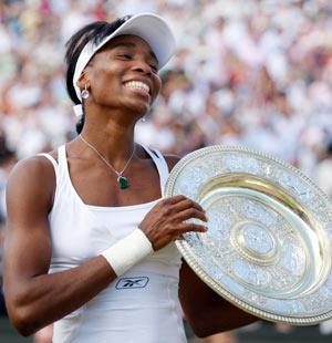 Вінас Уїльямс (Venus Williams) у черговий раз стала переможницею Уїмблдонського турніру. Фото: ADRIAN DENNIS/AFP/Getty Images