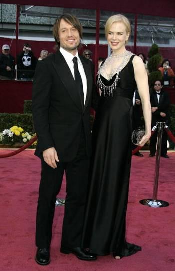 Актриса Николь Кидман (Nicole Kidman) и ее супруг музыкант Кейт Урбан (Keith Urban) посетили церемонию вручения Премии 'Оскар' в Голливуде Фото: Stan Honda/AFP/Getty Images