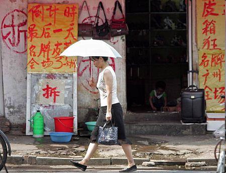 Мэрия Пекина приказала снести этот дом. Фото: FREDERIC J. BROWN/AFP/Getty Images