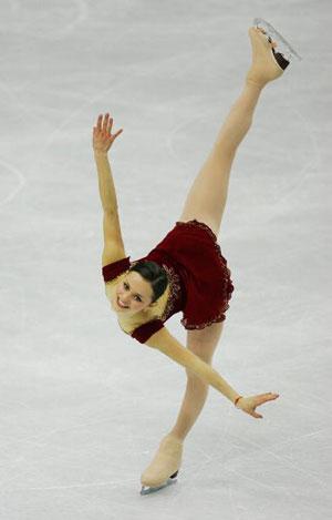 Произвольная программа на Олимпийских играх в Турине (Италия) в 2006 г.  Она выиграла «серебро». Фото: Al Bello/Getty Images