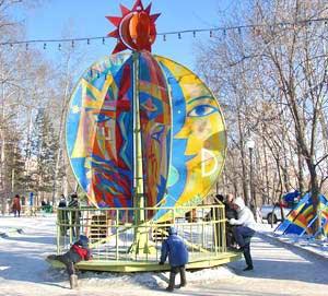 Діти катаються на атракціоні. Фото: Іван Поляков/Велика Епоха