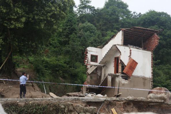 Разрушенный стихией дом. Провинция Хунань, Китай. Фото: STR/AFP/Getty Images