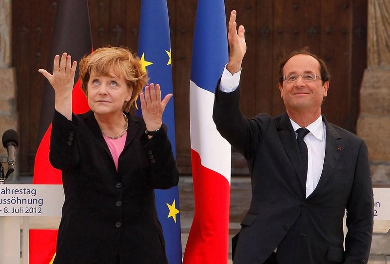 Реймс, Франция, 8 июля. Ангела Меркель и Франсуа Олланд встретились, чтобы отметить 50-летие символического примирения Германии и Франции после окончания Второй мировой войны. Фото: Patrick Aventurier/Getty Images
