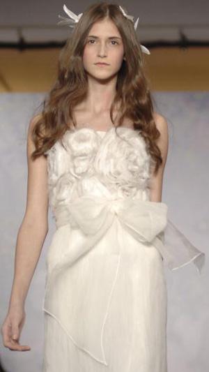 Коллекция свадебных платьев Моник Люлье (Monique Lhuillier).. Фото: H. Walker/Getty Images