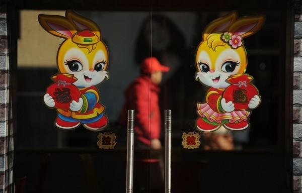 За китайським календарем 2011 - рік Кролика. Пекін. Китайська Народна Республіка. Фото: AFP PHOTO/Peter PARKS