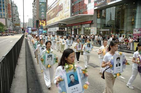 Скорбота за, майже, 3 тисячами (підтверджене на цей час число) загиблих від репресій учнів Фалуньгун, які здійснює КПК. Фото: Хуан Хао/Велика Епоха