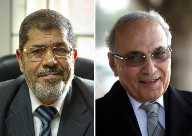 Лидирующие кандидаты первого тура в Египте: исламист Мохаммед Мурси (слева) и бывший премьер Хосни Мубарака Ахмед Шафик (справа). Фото: Халед DESOUKI/AFP/GettyImages