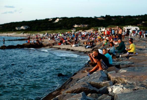 Туристи милуються заходом сонця. Фото: Win McNamee/Getty Images