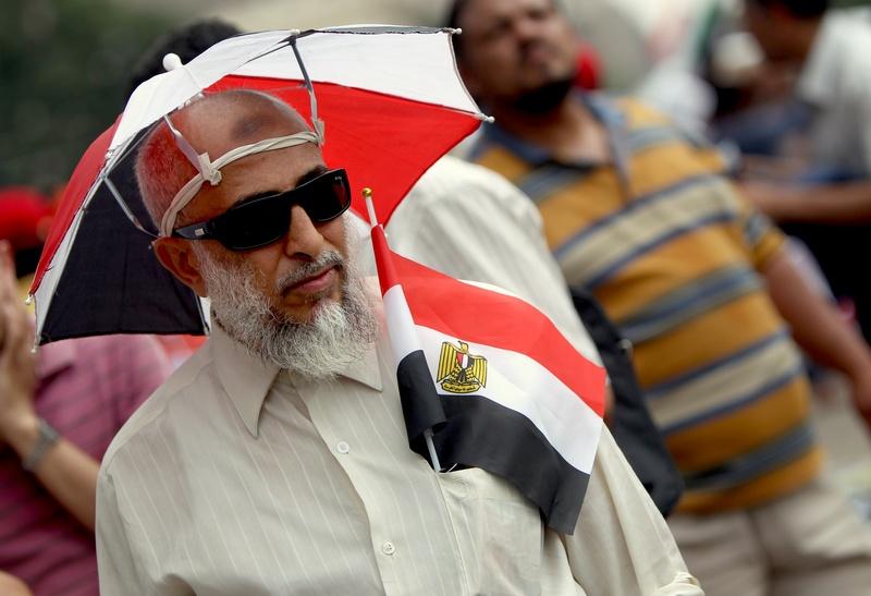 Каир, Египет, 23 июня. Жители страны выбирают нового президента. Фото: MARWAN NAAMANI/AFP/Getty Images