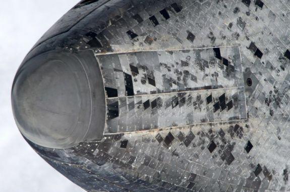 Нос космического челнока Атлантис, сфотографированные на орбите. Фото: NASA via Getty Images