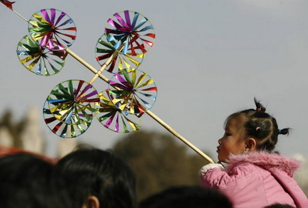 Китай. Пекин. Девочка перед парком Дитань. Фото: Peter Parks/AFP