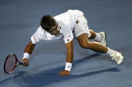 Янко Тіпсаревіч (Сербія) (Serbian tennis player Janko Tipsarevic) під час Відкритого чемпіонату Австралії з тенісу в Мельбурні. Фото: TORSTEN BLACKWOOD/AFP/Getty Images