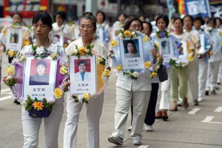 Скорбота за, майже, 3 тисячами (підтверджене на цей час число) загиблих від репресій учнів Фалуньгун, які здійснює КПК. Фото: У Лянь Ю/Велика Епоха