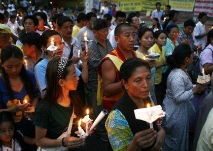 19 марта в Нью-Дели люди выражают протест против кровавого подавления тибетцев китайской компартией. Фото: Getty Images
