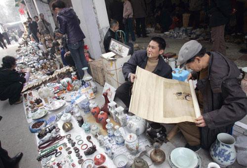 16 березня, 2007 р. Продавець м. Сіань на дорозі. Фото: Лю Цзинь/AFP/Getty Images