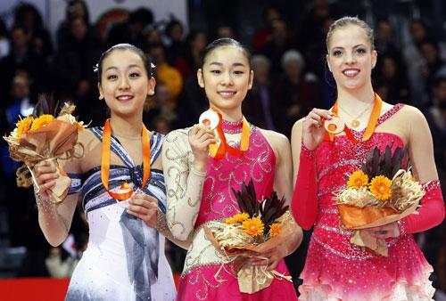 Слева направо: Мао Асада (Япония), Ю-На Ким (Южная Корея), Каролина Костнер (Италия). Фото: DAMIEN MEYER/AFP/Getty Images