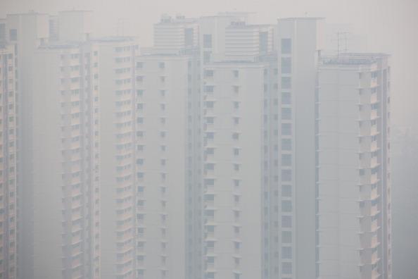 Небоскребы Сингапура в смоге. Фото: Chris McGrath/Getty Images