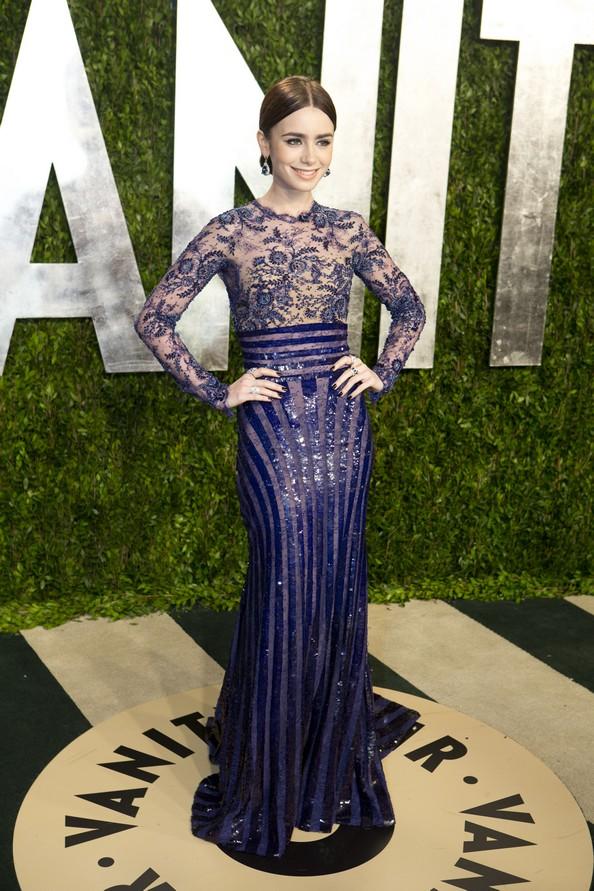 Лили Коллинз в платье от Zuhair Murad. Фото: ADRIAN SANCHEZ-GONZALEZ/AFP/Getty Images