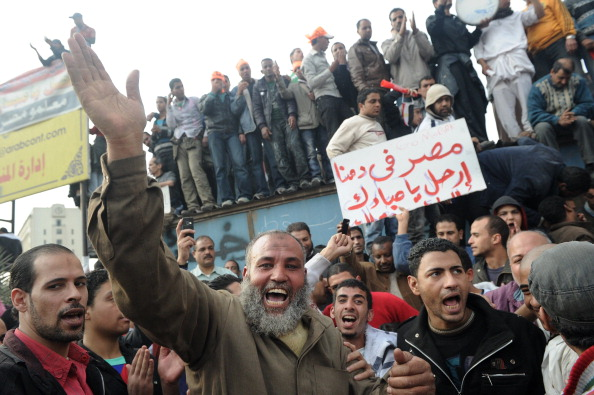 Граждане Египта массово вышли на улицы с требованиями отставки президента Хосни Мубарака. Фото:PETRAS MALUKAS/AFP/Getty Images