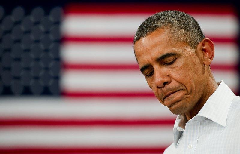 Маршалтаун, Айова, США, 14 августа. Барак Обама слушает высказывания учеников средней школы Миллера, которую он посетил во время 3-х дневной поездки по штату. Фото: JIM WATSON/AFP/GettyImages