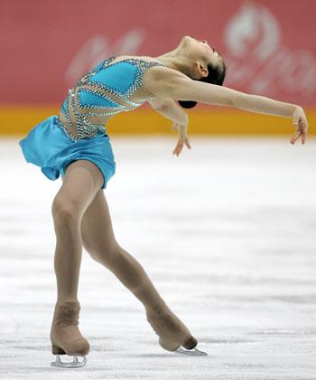 Короткая программа  на этапе Гран-При-2007 Cup of Russia в Москве. Фото: YURI KADOBNOV/AFP/Getty Images