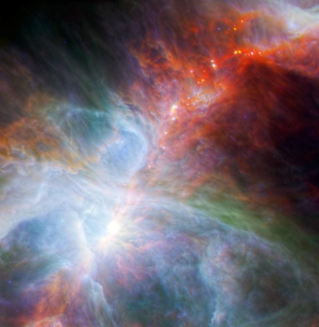 «Звёздные ясли» в Туманности Ориона (М42). Молодые светила окружены остатками газа и пыли в виде дисков. Фото: ESA/PACS/NASA/JPL-Caltech/IRAM