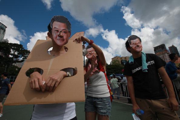 Демонстранты протестуют против нового главы Гонконга. Фото: AARON TAM /AFP/Getty Images