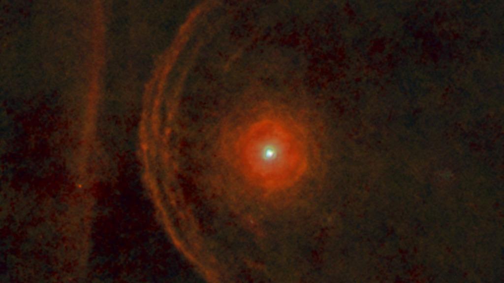 Червоний надгігант Бетельгейзе (сузір'я Оріона) в оточенні речовини, що викидається з надр світила. Фото: ESA/Herschel/PACS/L. Decin et al