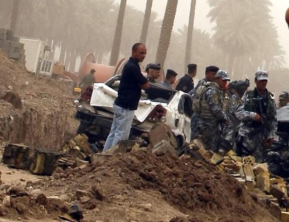 Теракты в Багдаде. Первый взрыв прогремел в районе Кадимия, в результате взрыва погибли 12 человека и 10 получили ранения. Фоторепортаж. Фото: SABAH ARAR/AFP/Getty Images