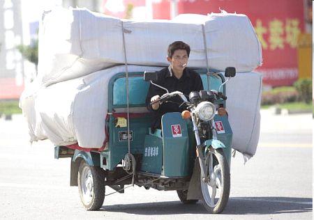 Грузовое пекинское такси. Фото: AFP/Getty Images