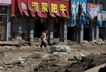 Уезд Юнцзи провинции Цзилинь после того, как вода отступила. 1 августа 2010 год. Фото: AFP