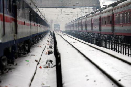 Вокзал г.Ухань провинции Хубэй. Стихийное бедствие, связанное с сильными снегопадами, охватило 14 провинций, городов и районов Китая. Фото: China Photos/Getty Images