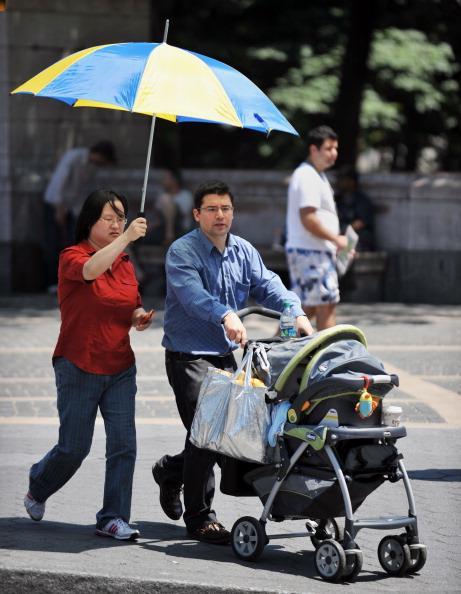 На восточное побережье США пришла сильнейшая жара. Фото: STAN HONDA/AFP/Getty Images