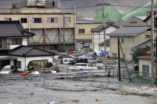 Последствия цунами в городе Kesennuma в префектуре Мияги которое произошло после сильного землетрясение в Японии. Март 2011 год. Фото: AFP PHOTO / Yomiuri Shimbun
