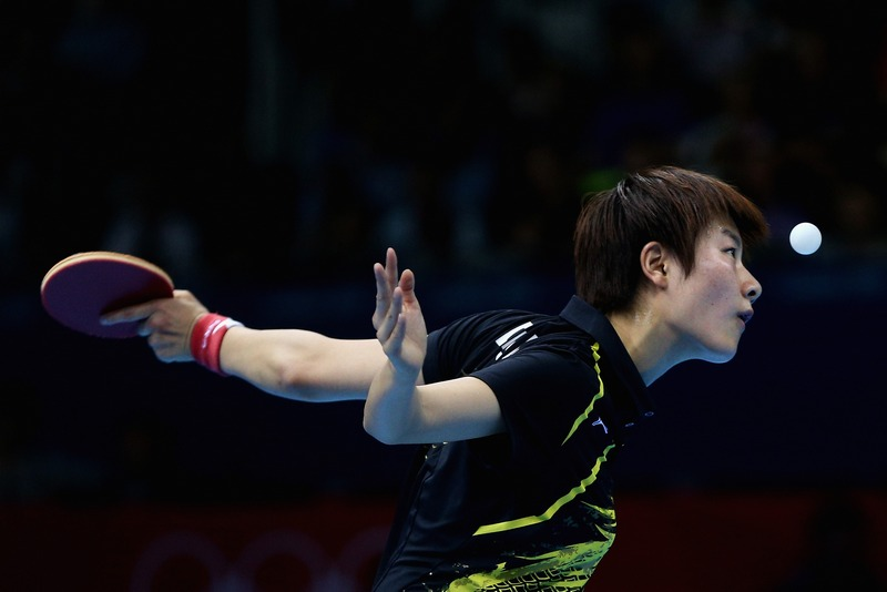 Лондон, Англія, 31 липня. Олімпійські Ігри 2012. Нін Дін (Китай) відіграє в матчі чвертьфіналу з настільного тенісу. Фото: Feng Li/Getty Images