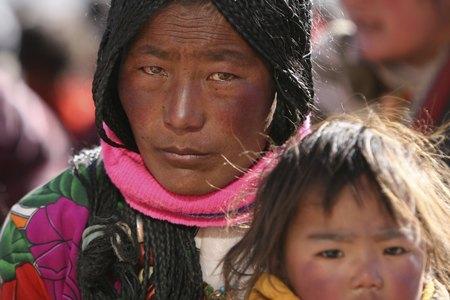 Мороз наклав відбиток на їх обличчя. Фото: China Photos/Getty Images