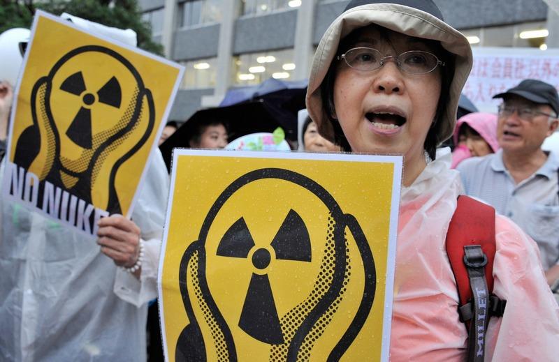 Токио, Япония, 20 июля. Демонстранты требуют прекратить использование атомной энергии. Фото: RIE ISHII/AFP/GettyImages