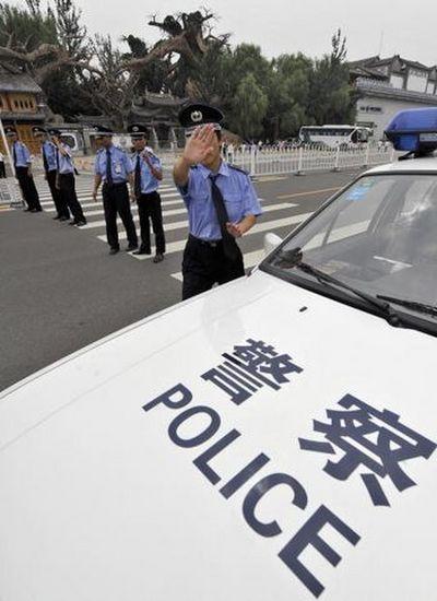 Пекинская полиция препятствует работе корреспондентов. Фото: JEWEL SAMAD/AFP/Getty Images
