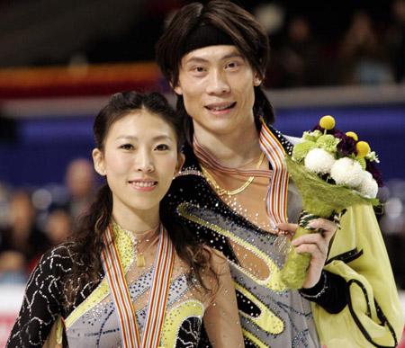 Китайська пара Pang Qing (L) і Tong Jian (R) на чемпіонаті світу з фігурного катання. Фото: TOSHIFUMI KITAMURA/AFP/Getty Images