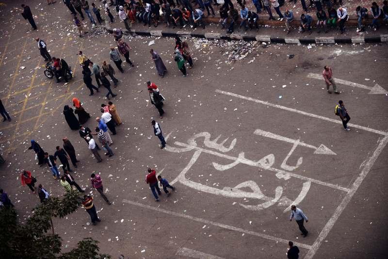 Каир, Египет, 24 ноября. Надпись на арабском языке на площади Тахрир: «Мурси, убирайся прочь!» — оппозиция выражает недовольство новым президентом страны. Фото: GIANLUIGI GUERCIA/AFP/Getty Images
