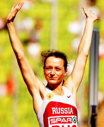 Мюнхен. Германия. Россиянка Yelena Slesarenko из России празднует победу в женских прыжках в высоту на Кубке Европы-2007 по лёгкой атлетике.  Фото: Ian Walton/Getty Images