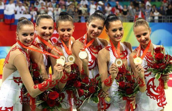 Команда спортсменок из России принесла своей стране 22-ую золотую медаль. Фото: AFP/Getty Images