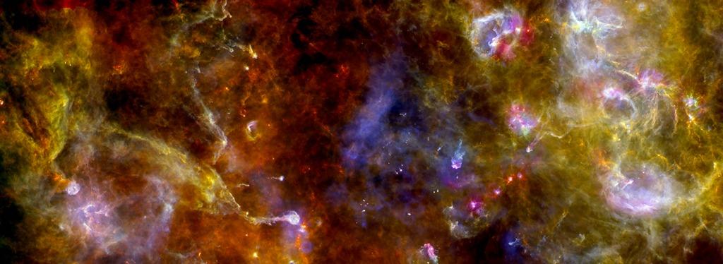 Новый взгляд на область образования светил в созвездии Лебедя. Насыщенные краски, смешение потоков пыли и газа. И молодые звёзды — вкрапления ярких точек. Фото: ESA/PACS/SPIRE/Martin Hennemann & Frederique Motte