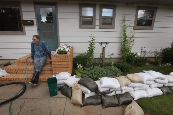 Наводнение уходит. г. Майнот, Северная Дакота, США. Фото: Scott Olson/Getty Images