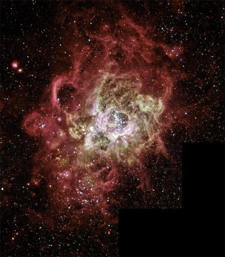 4 грудня 2003 р. Туманність NGC604. Фото: NASA and The Hubble Heritage Team (AURA/STScI)
