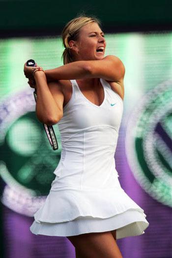 Лондон, Великобритания:  Maria Sharapova из России во время Уимблдонского турнира. фото: Alex Livesey/Getty Images