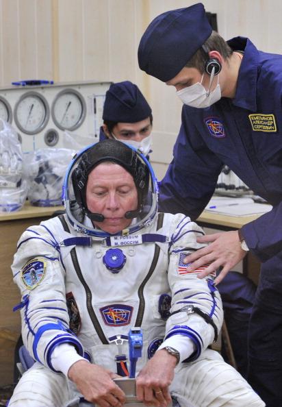 Майкл Фоссум в космическом кресле. Пока еще на Земле. Фото: VYACHESLAV OSELEDKO/AFP/Getty Images